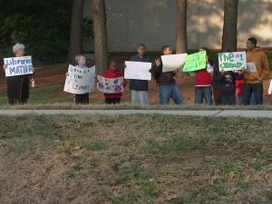 About 50 people gathered Wednesday afternoon at the Southeast Regional Library in Garner to rally support for keeping the library open.
