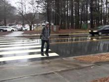 Driver charged after student hit in crosswalk