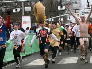 An estimated 6,000 runners participated in the 2010 Krispy Kreme Challenge in Raleigh on Saturday, Feb. 6. Racers in the Challenge have one hour to run two miles from the North Carolina State University Bell Tower to a Krispy Kreme store, eat a dozen donuts and return two miles to the finish line.