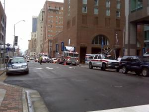 Emergency vehicles line the street in downtown Raleigh outside a hotel where illnesses were reported.