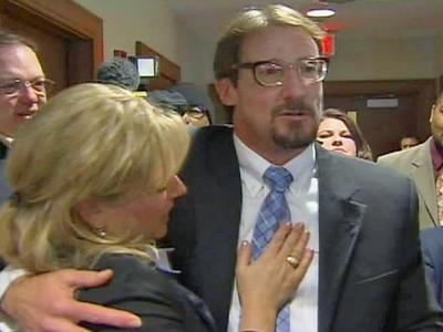 Gregory Taylor embraces Christine Mumma, executive director of the North Carolina Center on Actual Innocence, after being set free Wednesday, Feb. 17, 2010.