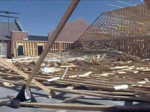 State inspectors spent Feb. 19, 2010, examining the rubble of a roof that collapsed the previous day at Mount Vernon Baptist Church in Clinton. One construction worker was killed in the collapse.