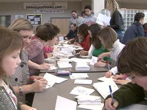 Members of Hope Community Church write thank-you notes to police officers and teachers on Sunday, Feb. 28, 2010.