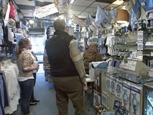 Customers buy UNC merchandise at the Shrunken Head, 155 East Franklin St., Chapel Hill.