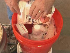 "A ""Bucket of Hope"" consists of a plastic five-gallon bucket packed with selected foodstuffs."