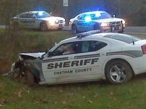 A Chatham County deputy lost control of his patrol car and crashed into a sign and a tree Monday morning on U.S. Highway 1 near Exit 79 while responding to a call.