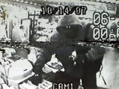 Oct. 14, 2007, surveillance video captures a masked man robbing Bobby's Grocery on Garner Road in Raleigh and shooting the store's owner, Tariq Hussain.