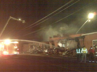 Firefighters work to extinguish a fire at a poultry processing plant in Maxton on April 2, 2010.