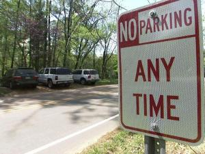 Raleigh officials have reached a compromise with residents who live near the Reedy Creek Road entrance to Umstead State Park to limit parking on their street.