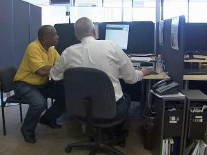 A person gets help filing tax returns at H&R Block, 4532 Capital Blvd., Raleigh, on Sunday, April 11, 2010.
