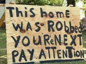 Pat Leal put up this sign in front of his McNeill Circle home in Fayetteville after he was robbed.