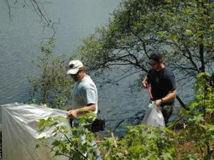 CA Cary employees Steven Michael and Benjamin Michael picking up litter around the lake. (Submitted by Emily Rosen)
