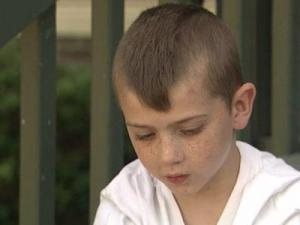 Devin Hogan, 8, has a BB lodged in his brain after being shot April 1 after an argument with some other young boys.
