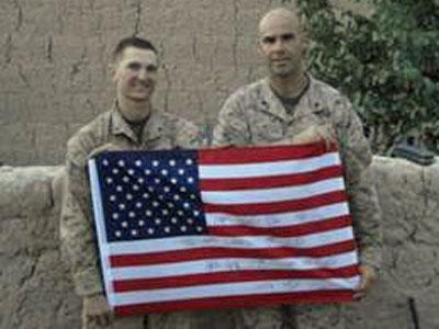 Lt. Col. John McDonough is taking the autographed flag to different Marine installations in Afghanistan.