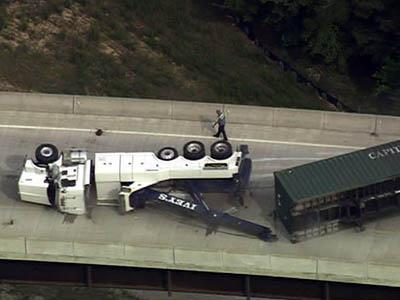 Tow truck flips trying to right semi :: WRAL com