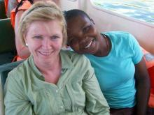 Donnas Kinton (left) sits with her adopted daughter Rose (right). Kinton meet Rose while on a mission trip to Uganda organized by the Wake Forest-based charity Embrace Uganda in 2008. (Photo courtesy of Embrace Uganda)