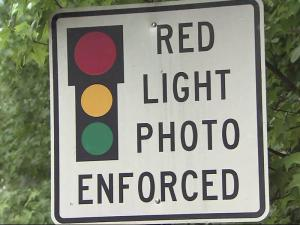 Red-light camera sign