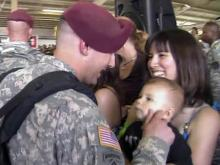 Troops return to cheers, smiles, hugs