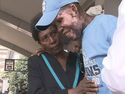 Eric Louis, a construction worker, suffered severe burns when a gas station exploded during the Jan. 12 earthquake in Haiti. He was brought to the North Carolina Jaycees Burn Center at UNC Hospitals in Chapel Hill for treatment. His wife Yvita helps him as he leaves the hospital on June 3, 2010.