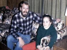 Carrie Wilkerson, right, sits with George Fisher in an undated photo. Chapel Hill police investigating a homicide a year after Wilkerson's slaying, found the photo of the two in Fisher's bedroom.