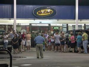 More than 50 people held a vigil Tuesday, June 29, 2010, outside the Exxon Short Stop Food Mart, at U.S. Highway 1 and Camp Easter Road in Lakeview, where Grace and Angus G. Kelly were shot a day earlier.