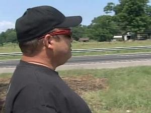 Ron Robinson on Sunday, July 11, 2010, returned to the scene of a Dunn crash that injured a woman earlier this week.