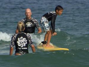 Dyan Ocampo, who is nearly blind, learns to surf.