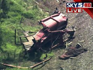 Amtrak train hits dump truck