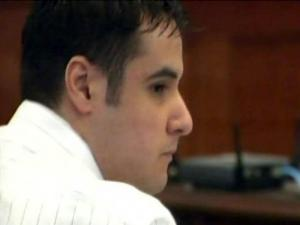 Cesar Laurean listens to testimony in his murder trial on Aug. 18, 2010. He is accused of killing a pregnant Camp Lejeune Marine in December 2007 and burying her in a fire pit behind his Jacksonville home.