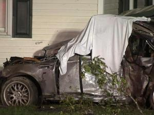 A 20-year-old man died and a 19-year-old man was in critical condition after they crashed into a house on Tryon Road around midnight.