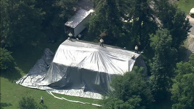 A tent covers the home at 506 Longfellow Street in Fuquay-Varina.