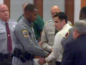 Cesar Laurean speaks briefly to his family as he is handcuffed and led from a Goldsboro courtroom on Aug. 23, 2010, following his conviction on a first-degree murder charge in the December 2007 death of Marine Lance Cpl. Maria Lauterbach.