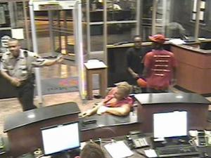 The Johnston County Sheriff's Office is trying to identify the man wearing the black shirt in this surveillance photo. He is believed to have been involved in an armed robbery at the Shop 'N Go, at N.C. Highway 42 and N.C. Highway 222 West on Aug. 25, 2010.