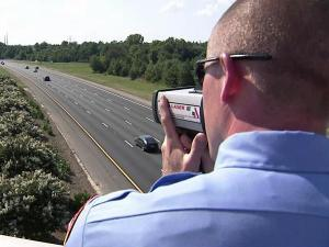 Instead of running radar from a patrol car on the side of the highway, Raleigh police used a hand-held device from the Lake Wheeler overpass to ticket speeders on Monday, Sept. 6, 2010.