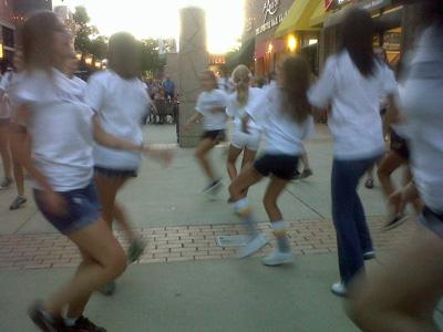 """In the middle of the Streets at Southpoint Mall, about 100 people broke out into a choreographed dance to the Journey song, """"Don't Stop Believing"""" on Sept. 10, 2010."""