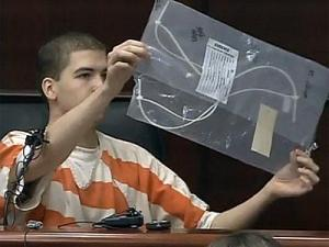 Testifying Sept. 14, 2010, Drew Shaw examines a zip tie submitted as evidence in the trial of Ryan Hare. Hare is charged with first-degree murder in the Nov. 30, 2008, death of Matthew Silliman.