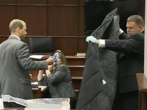 Wake County Assistant District Attorney Jason Waller, left, questions Thomas Como, an agent with the Wake County City-County Bureau of Identification, during the murder trial of Ryan Hare. Como shows jurors the sleeping bag in which Matthew Silliman was found wrapped on Dec. 2, 2008.