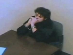 A video still of Ryan Hare being interviewed by a Wake County sheriff's investigator at the Wake County Public Detention Center on Dec. 3, 2008, hours after he was taken into custody for the death of Matthew Silliman.