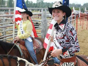 Bailey Hewat and Carlee  Whitt wait to carry the American flag at the beginning of the Benson Mule Days' NCHSRA rodeo on Sunday, Sept 26.