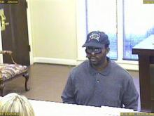 Surveillance images from a Zebulon bank show the man suspected in a series of Triangle bank robberies.
