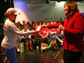 WRAL Smart Shopper Faye Prosser hands a door prize to a winner.