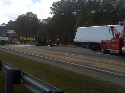 The wreckage of a mower sits on northbound I-95 in Cumberland County on Oct. 26, 2010, after it was hit by a tractor-trailer. The mower operator was killed in the wreck.