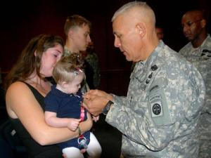 82nd Airborne commander Maj. General Jim Huggins presented the posthumous Purple Heart to 8-month-old Skylah Sherman and her mother Patricia Sherman in a ceremony at Fort Bragg on Thursday, Nov. 4, 2010. Sgt. Benjamin Sherman died while fighting in Afghanistan a year earlier. (Photo courtesy of the U.S. military)