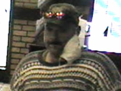 Nov. 16, 2010, surveillance photo of a man wanted in connection with a robbery and bomb threat at Friendly Jewelyr & Pawn in Durham.