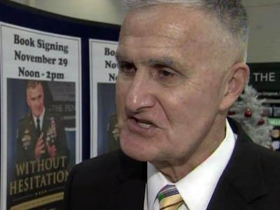 """Retired Army Gen. Hugh Shelton signed copies of his memoir, """"Without Hesitation,"""" at Fort Bragg on Nov. 29, 2010."""