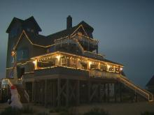 "The house made famous in the ""Nights at Rodanthe"" movie is decorated in 10,000 Christmas lights, 10 Christmas trees and more than 40 homemade bows."