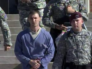 Military police escort Army Spc. Eric Mead from the courthouse on Fort Bragg on Dec. 7, 2010. Mead is charged with murder in connection with the May 2010 death of his brother-in-law on post.