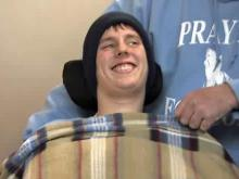 Student paralyzed in football game returns home