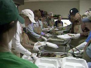 About 80 people volunteered work with the Gobbles to Go program to serve 730 turkey dinners to those in need.