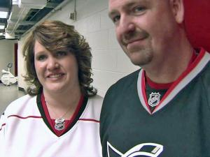 Die-hard Carolina Hurricanes fans Monica Ludlum, 38, and Alain Taylor, 39, got married on the ice at the RBC Center on Saturday, Jan. 15, 2011.